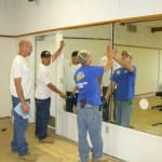 dance studio Casey,Carlos and Tyler installing a mirrored wall