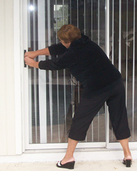Woman Trying To Open Stuck Door ...