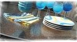 plates and glasses on glass table top
