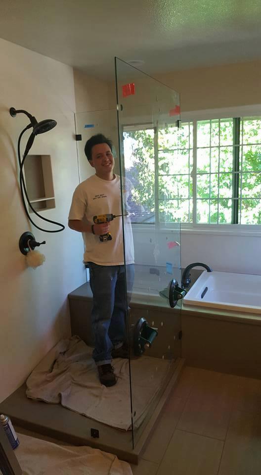 Anthony installs a frameless shower enclosure