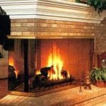 brick fireplace with wrap around glass door