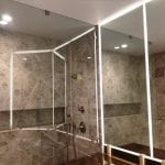 Large mirrors and glass shower