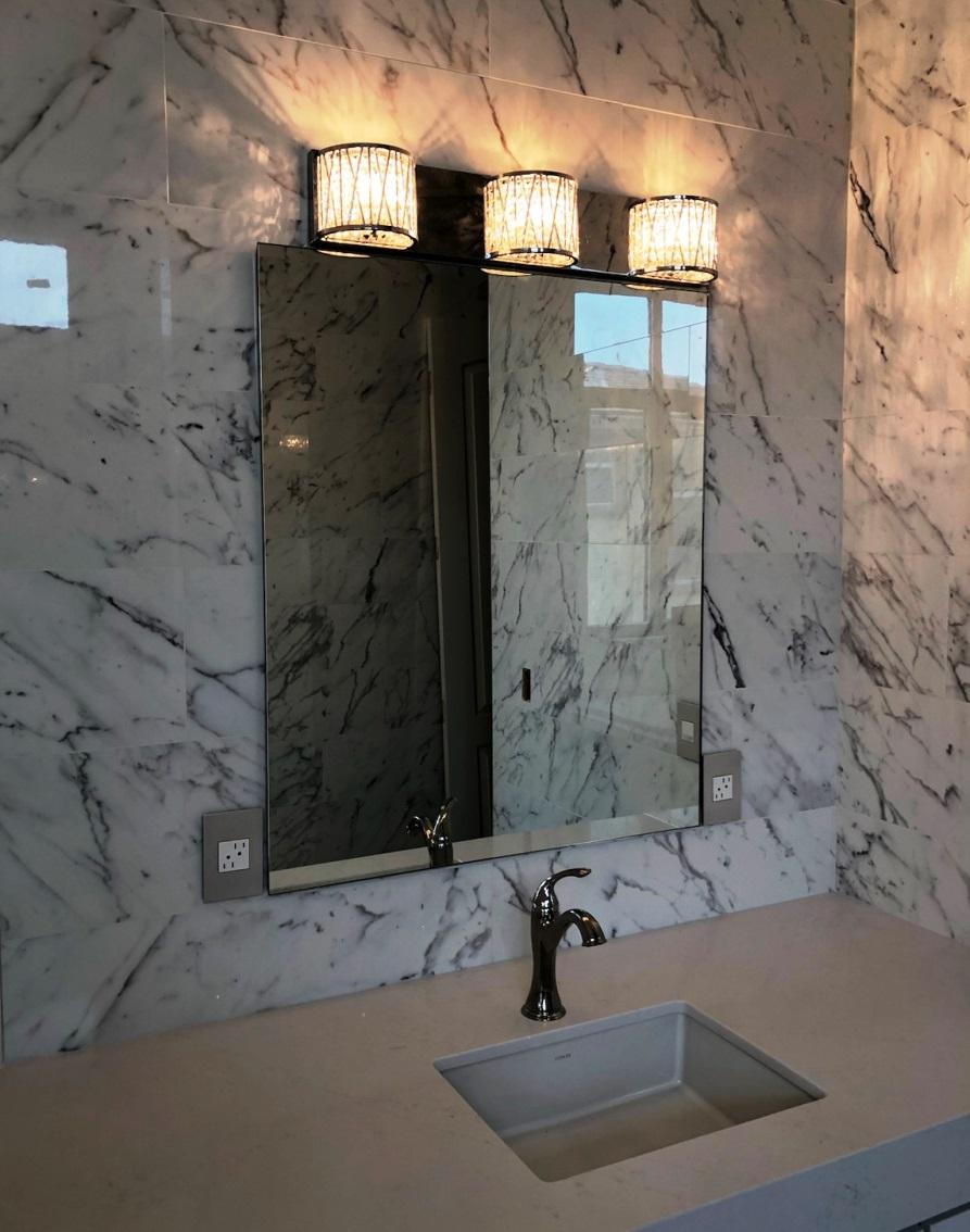 Bathroom mirror over square sink