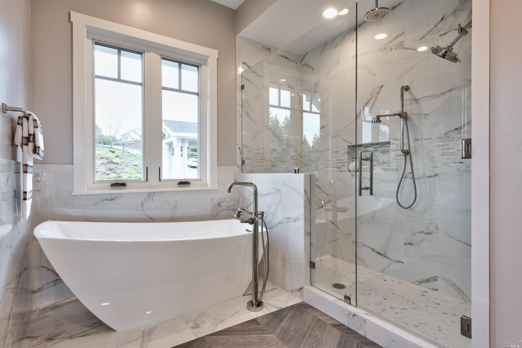Free standing white tub and Rocky Knoll Glass shower enclosure